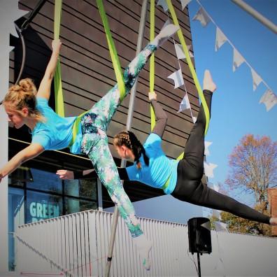 Two girls star on aerial hammocks