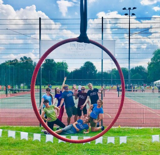 The team, pictured through an aerial hoop